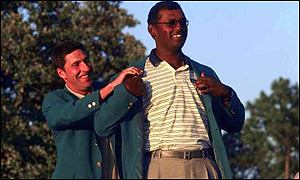 Olazabal puts the jacket on the back of Vijay Singh