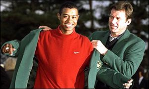 Nick Faldo presents Tiger Woods with the jacket