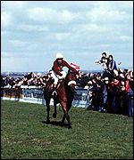 Red Rum makes history with his third Grand National victory