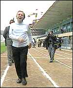 Sir Norman Wisdom clowns at the Tirana football stadium