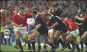 Frank Bunce makes a break for the All Blacks