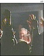 Ex-Yugoslav President Milosevic greeting supporters
