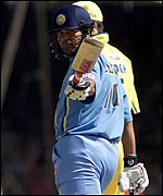 Tendulkar acknowledges the applause on reaching 10,000 runs