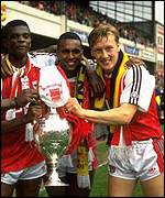 'Rocky' (c) celebrates winning the League title with Arsenal in 1991