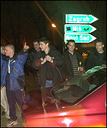 Serbs celebrate in Belgrade after the arrest