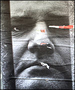 A poster in Belgrade shows Milosevic behind bars