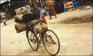 A woman pushes a load on her bicycle in southeastern Nigeria