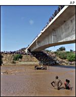 Divers working in the Sabaki river after a double bus crash