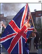 Protester burns British flag