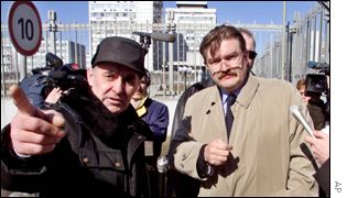 Yevgeny Kiselyov, right, NTV general director is stopped by a Gazprom guard