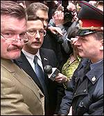 Police with ousted managing director Yevgeny Kiselyov