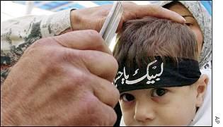 A Lebanese Shi'a Muslim man slashes the head of a three-year old boy with a razor.