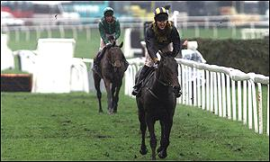 Tony McCoy with Blowing Wind trails home in third position