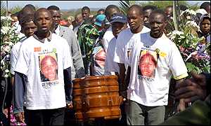 Mourners carry Tshepo Matloha's coffin