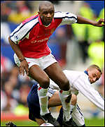 Patrick Vieira of Arsenal avoids the challenge of Tottenham's Chris Perry