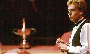 Terry Griffiths cats his eyes on the baize