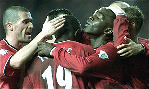 Andy Cole and team-mates