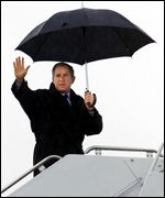 George Bush with umbrella AFP