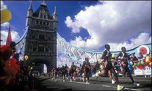 The elite runners lead the field across Tower Bridge at the half-way stage