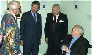 The Prince of Wales shared a joke with Sir Harry, Sir Jimmy Saville and Milligan at a reception at the Army Staff College