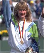 Steffi Graf shows off her Olympic Gold medal won in 1988, the year she won the Golden Slam of all four major tournaments as well as the Seoul Games