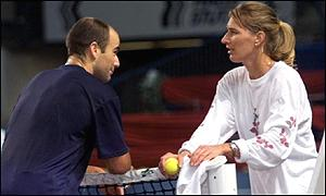 Andre Agassi and girlfriend Stefanie Graf share a moment over the net