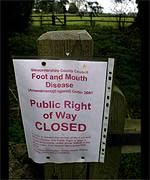 Foot-and-mouth sign on country footpath.
