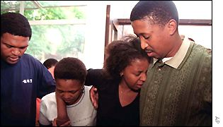 Relatives mourn victims of the Ellis Park disaster