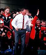Alex Ferguson celebrates his first trophy with United