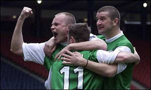 Hibs celebrate the opening goal at Hampden