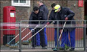 Police search blast site