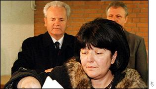 Mira Markovic voting, with Milosevic (in background)