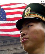 A Chinese guard stands outside the US embassy in Beijing as anti-US sentiment grows in the city