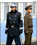 Two soldiers from North and South Korea at the countries' border
