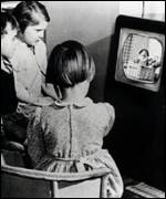 Children watch Andy Pandy