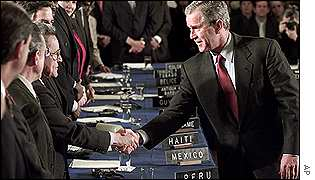 President Bush shake hands ahead of the Summit of the Americas