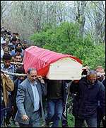 Relatives carry the coffin containing the body of a prisoner