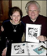 Artist Carolyn Edwards shows the sixth Doctor her portfolio