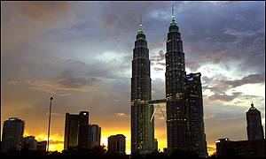 The Petronas Twin Towers, the worlds tallest buildings, crown Kuala Lumpur's skyline