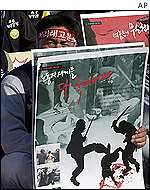 Sacked Daewoo workers in South Korea protest police brutality.