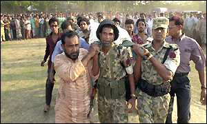 Injured Bangladeshi soldier being carried to safety