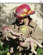 Fireman Chris Fields carryies the body of one year old Baylee Almon