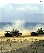US-made M-48 tanks firing on exercise