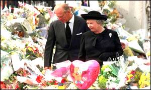 The Queen with Prince Phillip inspecting flowers left after the death of Princess Diana