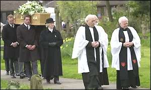Sir Harry Secombe's coffin is carried from church