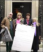 Joanna Lumley (centre left) and singer Lynsey De Paul (centre right) outside No. 10
