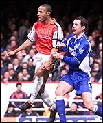 Henry beats Everton's Weir