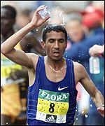 Abdelkader El Mouaziz cools down on his way to victory in the London Marathon