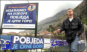 Man walks past pro-independence election posters