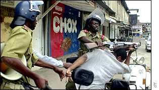Opposition supporter being attacked by Zanzibar police